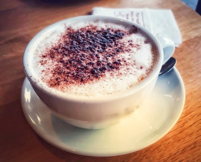 white cup filled with cappuccino