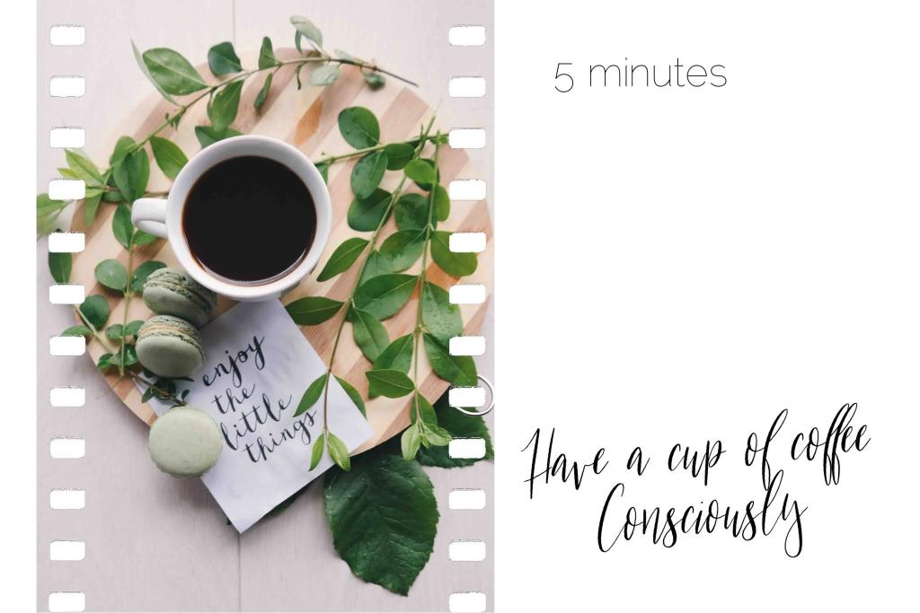 beautifully arranged cup of coffee, leaves, macaroons on a wooden plate. I wrote 5 minutes, have a cup of coffee consciously