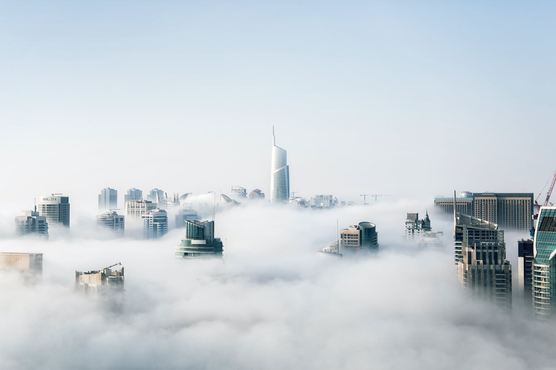 This image shows a city skyline but only the tallest buildings which poke out above the clouds. I believe that's Dubai